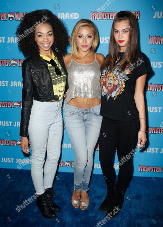 Stock Photo of Summer Reign, and from left, Millie Thrasher, and Celine Polenghi of the musical group Sweet Suspense attend Just Jared's Throwback Thursday Party Presented by Monster High at Moonlight Rollerway, in Glendale, Calif
