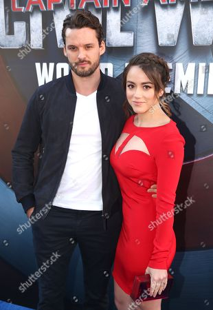"""Austin Nichols, left, and Chloe Bennet arrive at the Los Angeles premiere of """"Captain America: Civil War"""" at the Dolby Theatre on"""