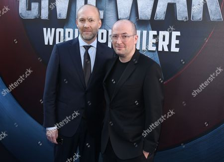 "Stephen McFeely, left, and Christopher Markus arrive at the Los Angeles premiere of ""Captain America: Civil War"" at the Dolby Theatre on"