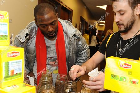Actor Hassan Johnson takes a tea-break at the Lipton Uplift Lounge amidst the hustle and bustle of Sundance, in Park City, UT