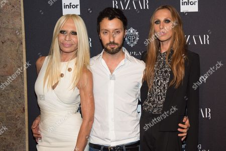 Stock Picture of Donatella Versace, Allegra Beck Versace, and a guest arrive at Harper's Bazaar ICONS by Carine Roitfeld celebration at The Plaza Hotel, in, New York