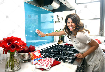In this photo released, Jillian Harris uses aMr. CleanMagic Eraser to wipe away cooking splatters while on the set of theMr. Clean Dirty Little Secret videoshoot in New York.Â