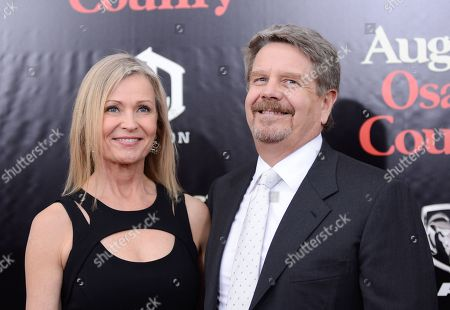 """Director John Wells and wife Marilyn Wells attend the """"August: Osage County"""" premiere at the Ziegfeld Theatre on in New York"""