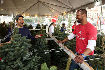 Old Spice Guy Isaiah Mustafa spreads holiday goodwill at Mr. Jingles  Christmas Tree Lot in ... - Tirelessly Stock Pictures, Editorial Images And Stock Photos