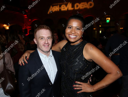 """Executive producer of Black Sails, Jon Steinberg, left, and creator/executive producer Courtney Kemp Agboh attends the premiere of STARZ' """"Ash vs. Evil Dead"""" at the TCL Chinese Theater, in Los Angeles"""