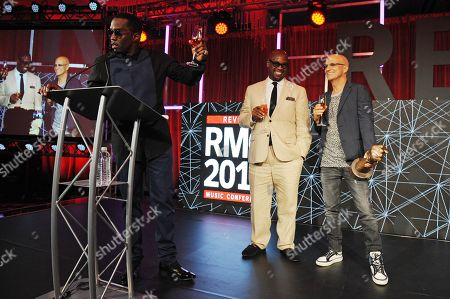 Sean Combs, Andre Harrell and Jimmy Iovine appear during the REVOLT Music Conference Gala Dinner at Fontainebleau Miami Beach, in Miami Beach, Fla