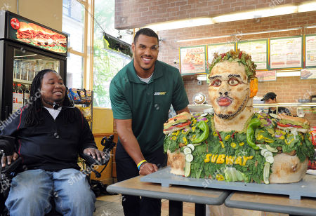 IMAGE DISTRIBUTED FOR SUBWAY - Eric LeGrand, left, SUBWAY Famous Fan and former Rutgers football player, looks on as Anthony Barr, 2014 draft prospect and newest SUBWAY Famous Fan, unveils a life-size food statue made of fresh vegetables, in New York. Barr joins a roster of fellow Famous Fans that include Robert Griffin III, Justin Tuck, Russell Westbrook, Pele and Michael Phelps