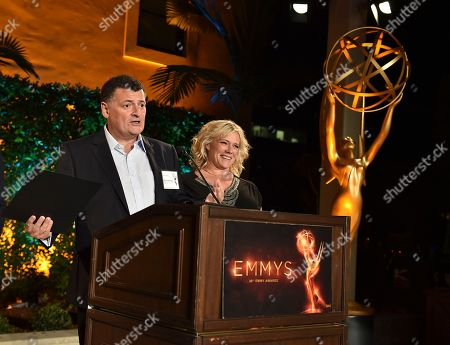 Steven Moffat, left, and Sue Vertue speak at the Television Academy's 2016 Producers Nominee Reception at the Montage Hotel, in Beverly Hills, Calif