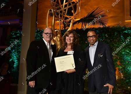 """Tim Gibbons, from left, Sally Young and Hayma """"Screech"""" Washington attend the Television Academy's 2016 Producers Nominee Reception at the Montage Hotel, in Beverly Hills, Calif"""