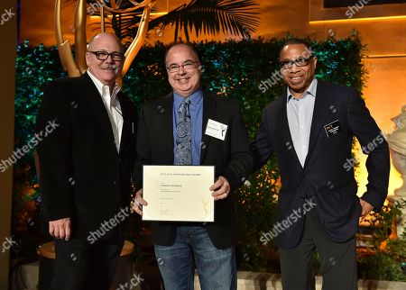 """Stock Image of Tim Gibbons, from left, Thomas Schnauz and Hayma """"Screech"""" Washington attend the Television Academy's 2016 Producers Nominee Reception at the Montage Hotel, in Beverly Hills, Calif"""