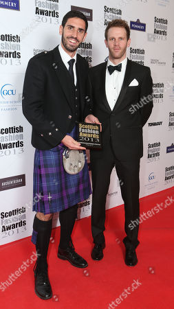 Dave Lochhead, left, holds the Accessory Designer of the Year Award at the 8th Annual Scottish Fashion Awards 2013 dinner, celebrating Scotland's fashion talent, at 8 Northumberland Avenue in central London, as part of a Scottish fashion invasion of London