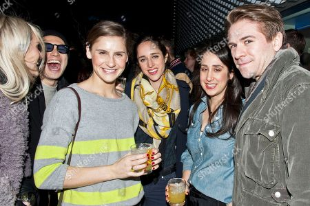 Stock Image of Eugene Tong, second left, and Justin Berkowitz, right, with guests attend the Digital Mavericks event hosted by Details magazine, at the New Museum in New York