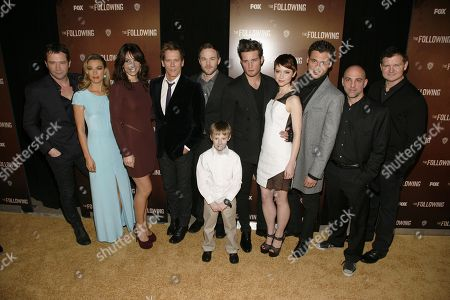 "From left, cast members James Purefoy, Natalie Zea, Annie Parisse, Kevin Bacon, Shawn Ashmore, Kyle Catlett, Nico Tortorella, Valorie Curry, Adan Canto, director Marcos Siega and screenwriter Kevin Williamson attend the world premiere of ""The Following"" event, at the New York Public Library on in New York"