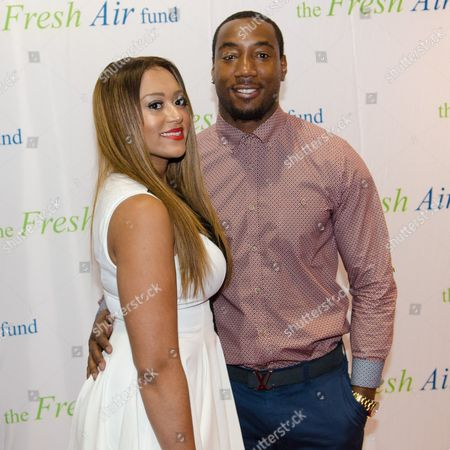 Stock Picture of Mario Manningham (R) and a guest arrive at The Fresh Air Fund Spring Gala Benefit at Pier Sixty at Chelsea Piers on in New York