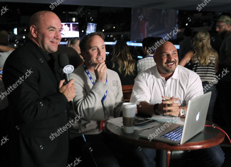 From left, UFC President Dana White, Jay Mohr and Jay Glazer attend the UFC on Fox event at Staples Center, in Los Angeles