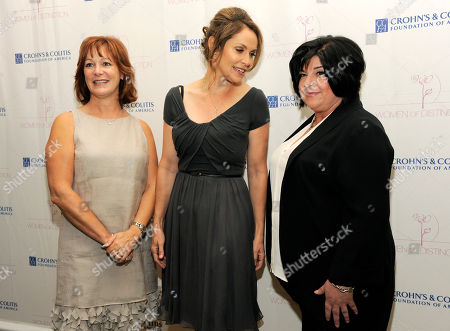 Honorees Lisa Greer, left, Amy Brenneman, center, and Susan Cartsonis mingle at The Crohn's and Colitis Foundation of America's Women of Distinction Luncheon at The Beverly Hills Hotel on in Beverly Hills, Calif