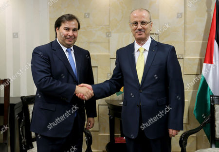 Palestinian Prime Minister Rami Hamdallah meets with President of Brazilian Lower House Rodrigo Maia, at his office, in the West Bank city of Ramallah