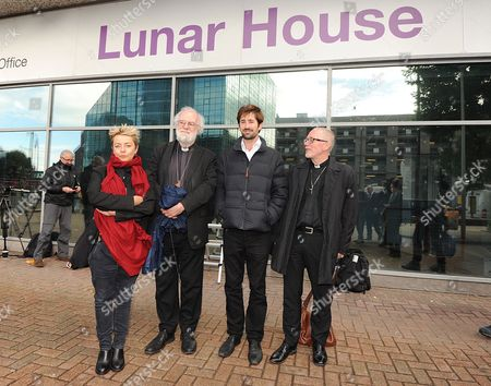 Dr Rowan Williams Former Archbishop Of Canterbury (second From Left) Welcomes The Refugees To Croydon After He Is Brought Over From Calais. Refugee Children From Calais Arrive In Croydon At The Home Office Lunar House To Register Themselves In The  UK . 2016/10/17.