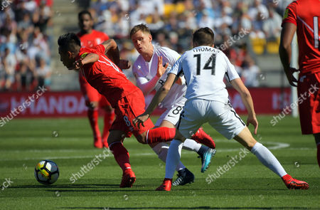 Stock Photo of Peru's Wilder Cartagena tries to get past Michael McGlinchey and Ryan Thomas (14) during the 2018 FIFA World Cup Russia first-leg playoff football match between the NZ All Whites and Peru at Westpac Stadium in Wellington, New Zealand on Saturday, 11 November 2017. Photo: Dave Lintott / lintottphoto.co.nz