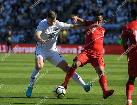 New Zealand's Tommy Smith holds off Peru's Wilder Cartagena (right) during the 2018 FIFA World Cup Russia first-leg playoff football match between the NZ All Whites and Peru at Westpac Stadium in Wellington, New Zealand on Saturday, 11 November 2017. Photo: Dave Lintott / lintottphoto.co.nz