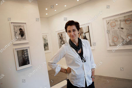 "Stock Picture of American photographer Alexandra Hedison poses in her exhibition space, in Paris, . Hedison's first Paris exhibit entitled ""The In Between"" was partly inspired by the recent spate of extremist attacks in the city"