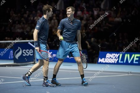 Andy Murray in action alongside Jamie Murray in a doubles match against Tim Henman and Mansour Bahrami. Andy Murray returns after injury to play in a Charity Exhibition Tennis match against Roger Federer at the SSE Hydro Arena  in Glasgow.