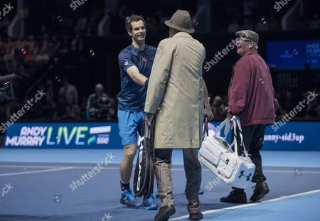 Andy Murray greets Scotland's most famous pensioners, Jack and Victor from Scottish Comedy Still Game, during his doubles match alongside Jamie Murray against Tim Henman and Mansour Bahrami. Andy Murray returns after injury to play in a Charity Exhibition Tennis match against Roger Federer at the SSE Hydro Arena  in Glasgow.