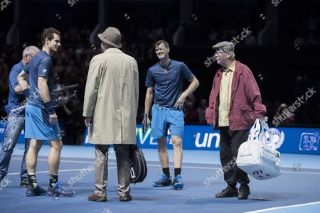 Andy and Jamie Murray greet Scotland's most famous pensioners, Jack and Victor from Scottish comedy Still Game, during their doubles match against Tim Henman and Mansour Bahrami. Andy Murray returns after injury to play in a Charity Exhibition Tennis match against Roger Federer at the SSE Hydro Arena  in Glasgow.