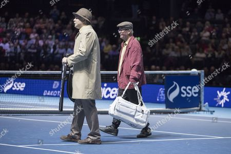 Scotland's most famous pensioners, Jack and Victor from Scottish comedy Still Game, walk onto the court during the doubles match between Andy and Jamie Murray and Tim Henman and Mansour Bahrami. Andy Murray returns after injury to play in a Charity Exhibition Tennis match against Roger Federer at the SSE Hydro Arena  in Glasgow.