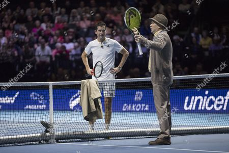 Tim Henman and Mansour Bahrami play against Scotland's most famous pensioners, Jack and Victor from Scottish comedy Still Game, during their doubles match against Andy and Jamie Murray. Andy Murray returns after injury to play in a Charity Exhibition Tennis match against Roger Federer at the SSE Hydro Arena  in Glasgow.