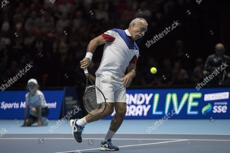 Mansour Bahrami in action alongside Tim Henman during their doubles match against Andy and Jamie Murray. Andy Murray returns after injury to play in a Charity Exhibition Tennis match against Roger Federer at the SSE Hydro Arena  in Glasgow.