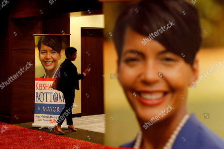 Banners with the image of Atlanta city councilwoman and mayoral candidate Keisha Lance Bottoms decorate the lobby outside her election night party ahead of her arrival in Atlanta, . Nearly a dozen candidates are competing to succeed term-limited Atlanta Mayor Kasim Reed. With so many contenders running, it's a safe bet that some of these elections won't be settled Tuesday. For any race in which no candidate wins more than 50 percent of the vote, the top two finishers will return for a runoff election Dec. 5