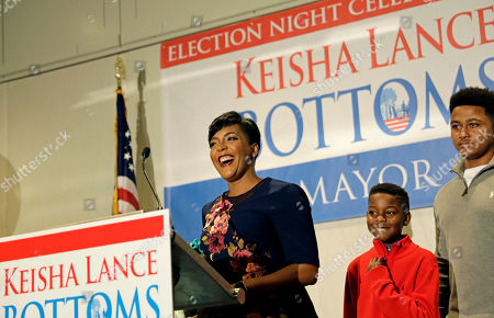 Atlanta city councilwoman and mayoral candidate Keisha Lance Bottoms steps onstage with her sons Langston, center, and Lance, right, to speak at an election night party in Atlanta, . Nearly a dozen candidates are competing to succeed term-limited Atlanta Mayor Kasim Reed. With so many contenders running, it's a safe bet that some of these elections won't be settled Tuesday. For any race in which no candidate wins more than 50 percent of the vote, the top two finishers will return for a runoff election Dec. 5