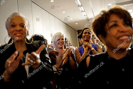 Supporters of Atlanta city councilwoman and mayoral candidate Keisha Lance Bottoms, including her mother, Sylvia Robinson, center left, applaud as she speaks at an election night party in Atlanta, . Nearly a dozen candidates are competing to succeed term-limited Atlanta Mayor Kasim Reed