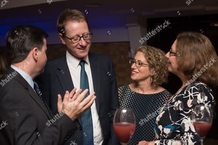Stock Photo of Jonathan Freedland with his wife Sarah Peters, Chairperson of the New Israel Fund UK Annual Dinner, along with Rt Hon Douglas Alexander MP and his wife Jacqueline Alexander.