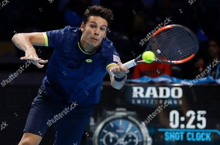 Gianluigi Quinzi of Italy returns the ball to Andrey Rublev of Russia during the ATP Next Gen tennis tournament finals, at the Rho fair, near Milan, Italy