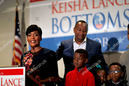 Keisha Lance Bottoms, Derek Bottoms. Atlanta city councilwoman and mayoral candidate Keisha Lance Bottoms speaks at an election night party with her children Langston, 9, from left, Lincoln, 7, Lennox, 7, and husband Derek Bottoms in Atlanta, . Nearly a dozen candidates are competing to succeed term-limited Atlanta Mayor Kasim Reed. With so many contenders running, it's a safe bet that some of these elections won't be settled Tuesday. For any race in which no candidate wins more than 50 percent of the vote, the top two finishers will return for a runoff election Dec. 5