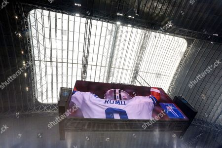 An image of former Dallas Cowboys quarterback Tony Romo is shown on the large video screen in this general, overall, view, of AT&T Stadium during a pregame ceremony honoring Romo before an NFL football game against the Kansas City Chiefs, in Arlington, Texas