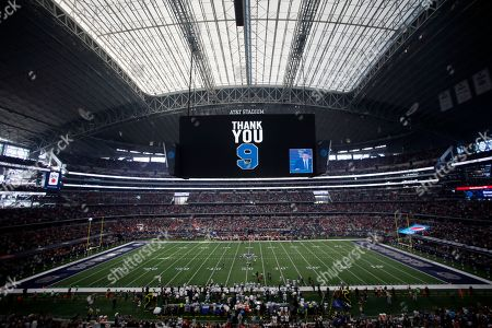 A message to former Dallas Cowboys quarterback Tony Romo, seen on the bottom right hand of screen, is shown in this general, overall, view, of AT&T Stadium during a short tribute honoring Romo before an NFL football game against the Kansas City Chiefs, in Arlington, Texas
