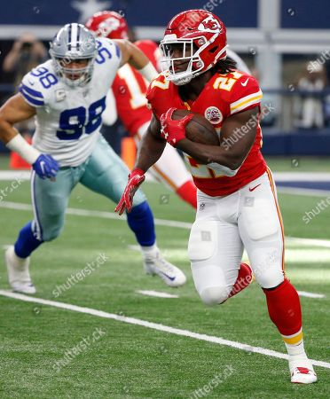 Tyrone Crawford, Kareem Hunt. Kansas City Chiefs running back Kareem Hunt (27) carries the ball as Dallas Cowboys' Tyrone Crawford (98) gives chase during an NFL football game, in Arlington, Texas