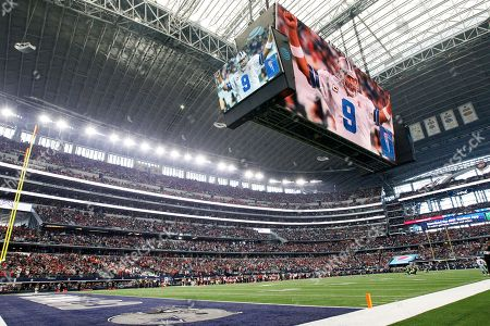 A video tribute to former Dallas Cowboys quarterback and current CBS color commentator Tony Romo plays on the video board before an NFL football game against the Kansas City Chiefs, in Arlington, Texas