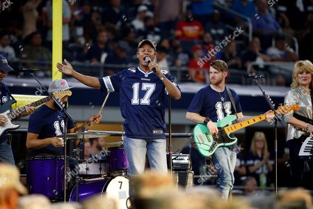 Entertainer Neal McCoy performs during a half time show of an NFL football game between the Kansas City Chiefs and Dallas Cowboys, in Arlington, Texas. The performance was part of the NFL's Salute To Service campaign as they honor members of the U.S. military