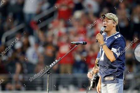 Stock Picture of Country music singer Neal McCoy performs during a Salute to Service halftime show during an NFL football game between the Kansas City Chiefs and Dallas Cowboys, in Arlington, Texas