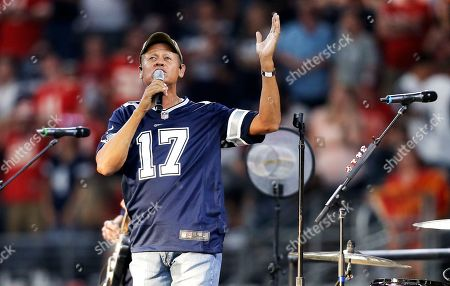 Stock Photo of Country music singer Neal McCoy performs during a Salute to Service halftime show during an NFL football game between the Kansas City Chiefs and Dallas Cowboys, in Arlington, Texas