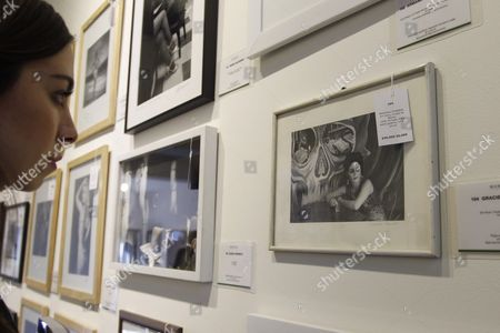 A woman looks at pictures by Graciela Iturbide that will be part of an auction next Thursday, in Mexico City,Mexico, 07 November 2017. A picture of the iconic actress Liz Taylor the day of her wedding at the Acapulco port with her third husband Michael Todd, and portraits of Diana, Princess of Wales, short before she died in a car accident, stand out among the artworks that will be auctioned.