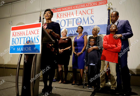 Atlanta city councilwoman and mayoral candidate Keisha Lance Bottoms speaks at an election night party surrounded by family in Atlanta, early . Nearly a dozen candidates are competing to succeed term-limited Atlanta Mayor Kasim Reed. With so many contenders running, it's a safe bet that some of these elections won't be settled Tuesday. For any race in which no candidate wins more than 50 percent of the vote, the top two finishers will return for a runoff election Dec. 5