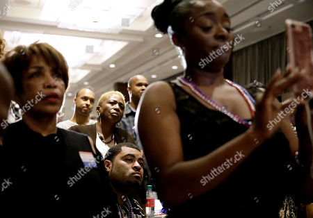 Stock Picture of Supporters watch as Atlanta city councilwoman and mayoral candidate Keisha Lance Bottoms speaks at an election night party in Atlanta, early . Nearly a dozen candidates are competing to succeed term-limited Atlanta Mayor Kasim Reed. With so many contenders running, it's a safe bet that some of these elections won't be settled Tuesday. For any race in which no candidate wins more than 50 percent of the vote, the top two finishers will return for a runoff election Dec. 5