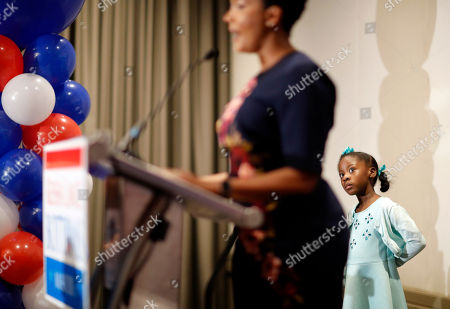 Atlanta city councilwoman and mayoral candidate Keisha Lance Bottoms speaks as her daughter Lincoln, 7, watches at an election night party in Atlanta, early . Nearly a dozen candidates are competing to succeed term-limited Atlanta Mayor Kasim Reed. With so many contenders running, it's a safe bet that some of these elections won't be settled Tuesday. For any race in which no candidate wins more than 50 percent of the vote, the top two finishers will return for a runoff election Dec. 5