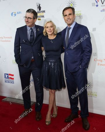 John Oliver, Bob Woodruff, Lee Woodruff. Comedian John Oliver, from left, Co-Founders of the Bob Woodruff Foundation Bob Woodruff and Lee Woodruff attend the 11th Annual Stand Up for Heroes benefit, presented by the New York Comedy Festival and The Bob Woodruff Foundation, at the Theater at Madison Square Garden, in New York