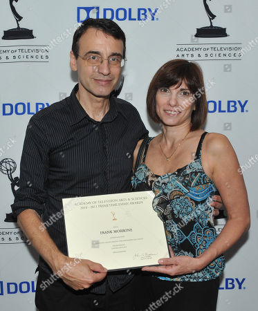 BURBANK, CA - SEPTEMBER 8: Academy Television Governor Frank Morrone and wife Gina Morrone pose at the 2011 Academy of Television Arts and Sciences Sound Mixing & Sound Editing Nominee Reception held at the Dolby Labs in Burbank, California, Thursday September, 8 2011